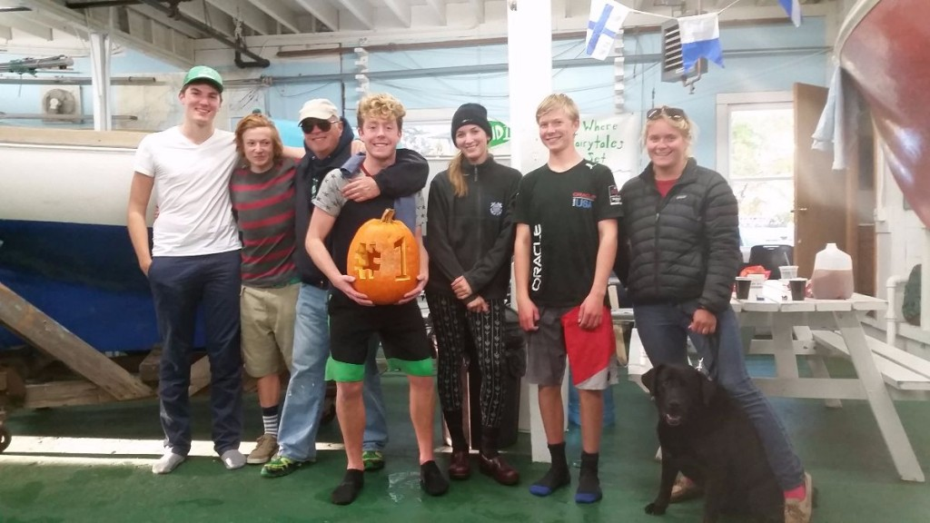 Members of the Mount Desert Island Community Sailing Center fall racing team celebrated the end of the season with an intra-squad singlehanded Pumpkin Regatta last Tuesday. From left, Hutchin Gerrish, Kincaid MacCullough, Coach John Macauley, pumpkin winner Chris Booher, Lilly Anderson, Connor Ratcliff, Coach Liana Folger and her dog Sampson. PHOTO COURTESY OF MDI COMMUNITY SAILING